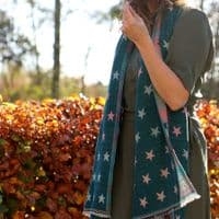 POM Peace Of Mind Reversible Scarf with Jacquard Stars in Teal and Pastel Multi Colour